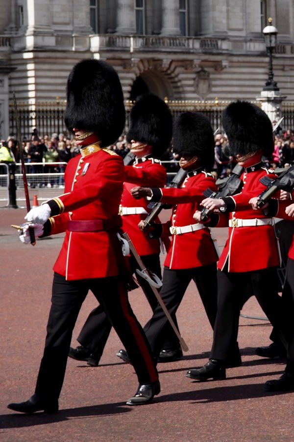 How long do the guards stand in front of Buckingham Palace?
